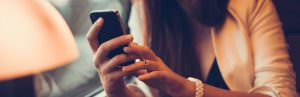 woman with cell phone social media infidelity